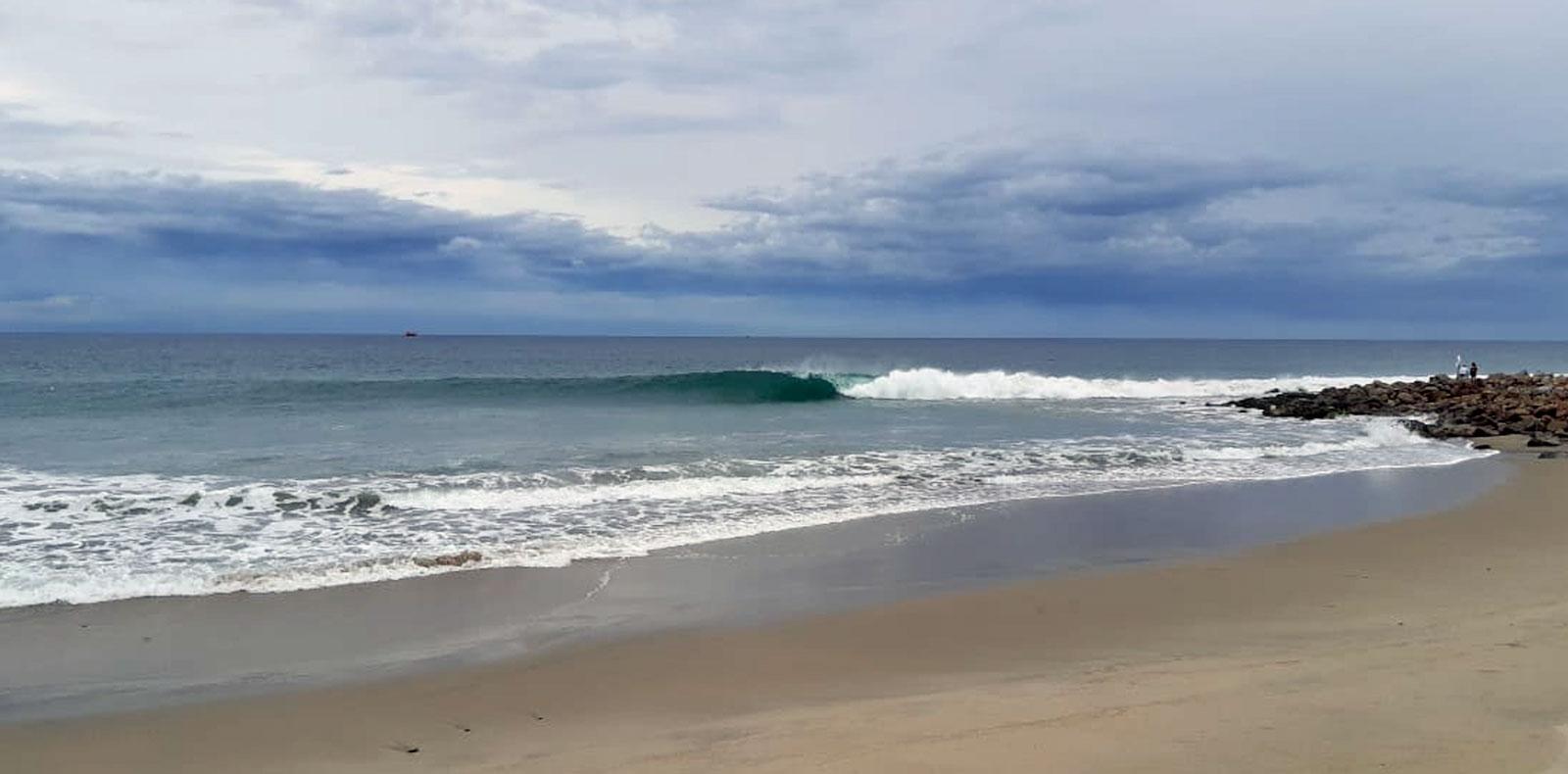 surfing under stormy skies in salina cruz, oaxaca, mexico, las palmeras surf camp